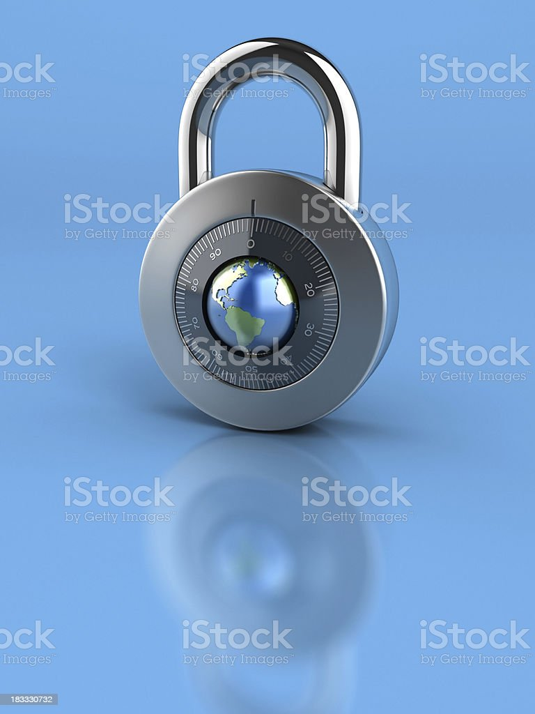 Combination Lock with globe dial on blue background royalty-free stock photo