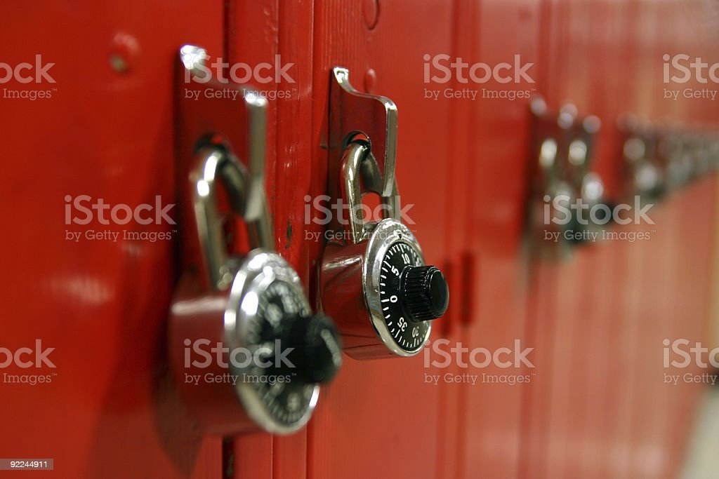 Combination locks on a row of red high school lockers stock photo