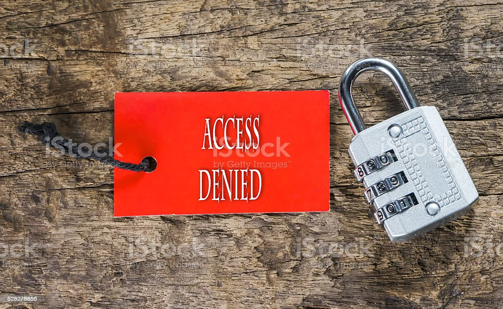 Combination number padlock on wood background with Access Denied stock photo