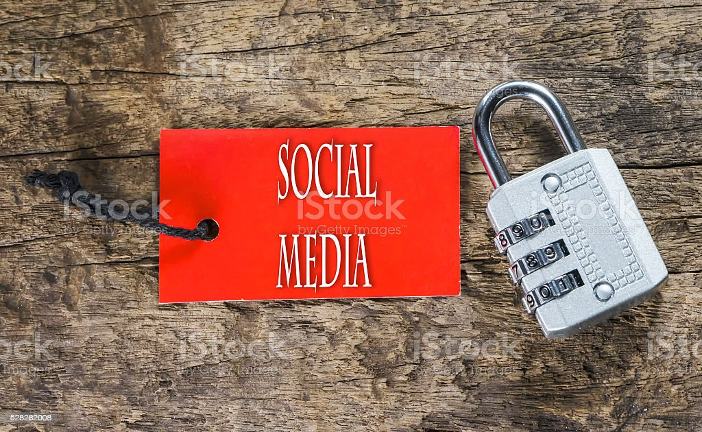 Combination number padlock on wood background with Social Media stock photo