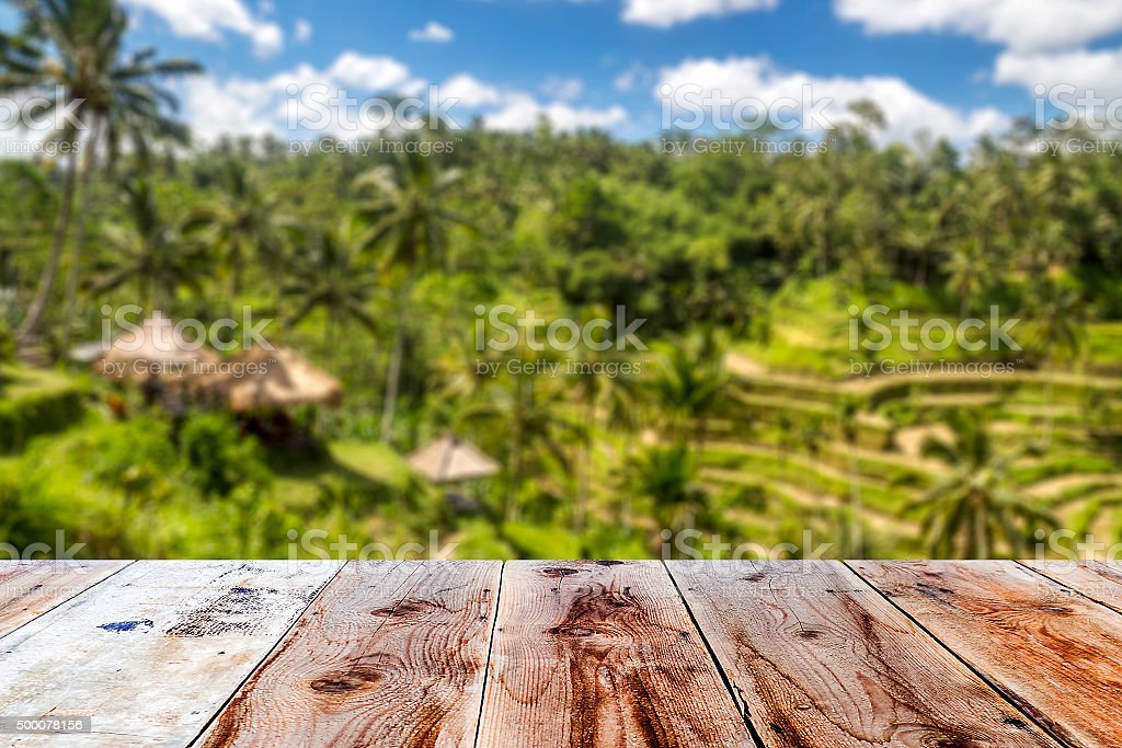 combination of wooden front with blurred balinese tropical clima stock photo