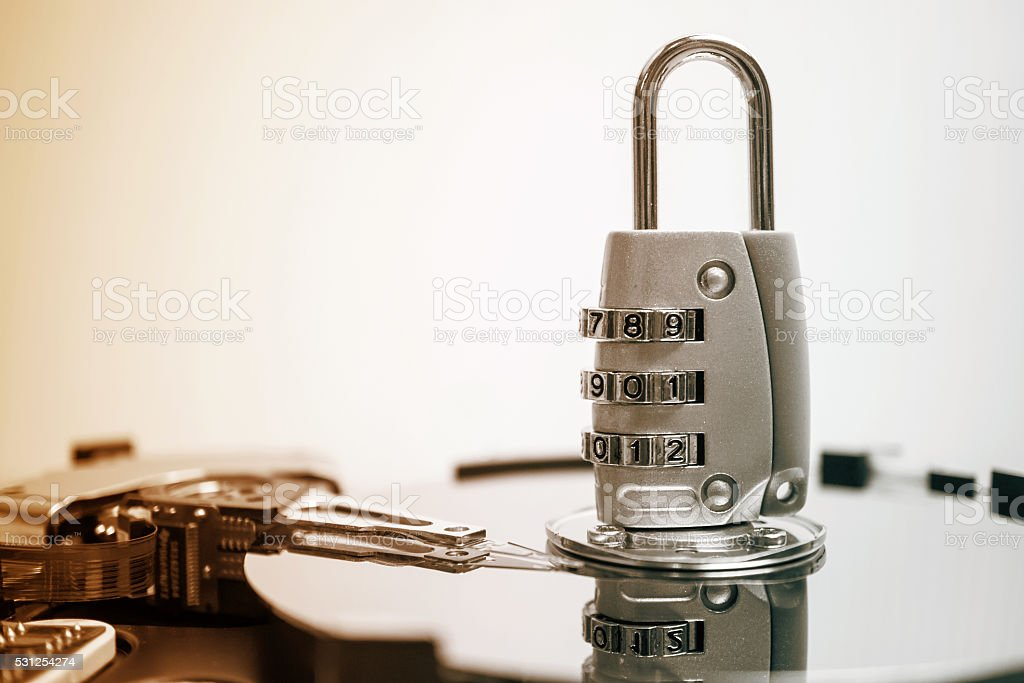 combination padlock on hard disk computer for security data concept stock photo