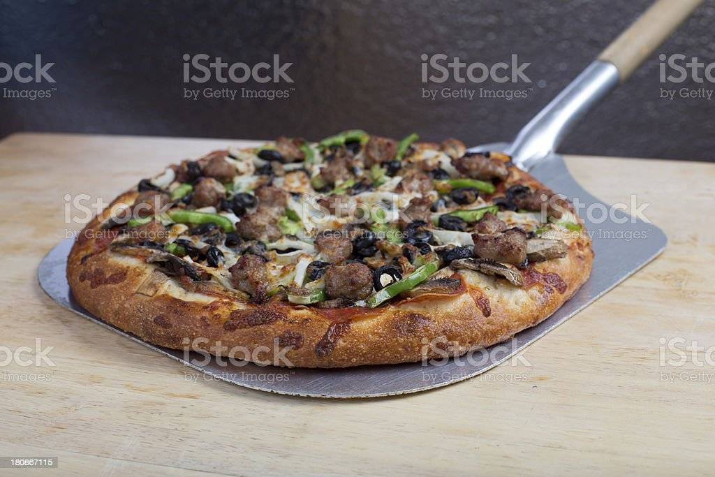 Combination pizza fresh out of the oven royalty-free stock photo