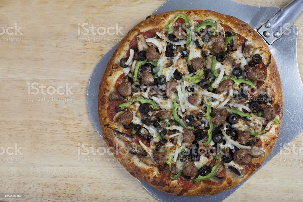 Combination pizza on a pan royalty-free stock photo