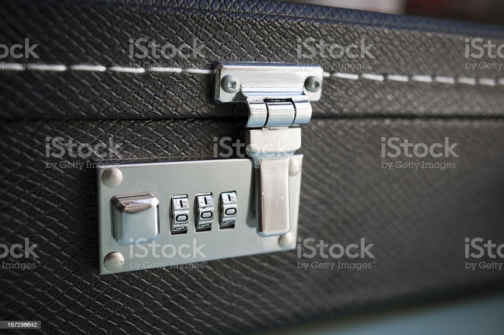 Combination Security Lock On A Leather Guitar Case royalty-free stock photo