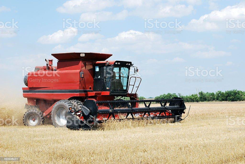 Combine cutting Kansas Wheat royalty-free stock photo