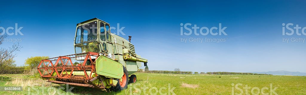 Combine harvester, clear blue horizon royalty-free stock photo