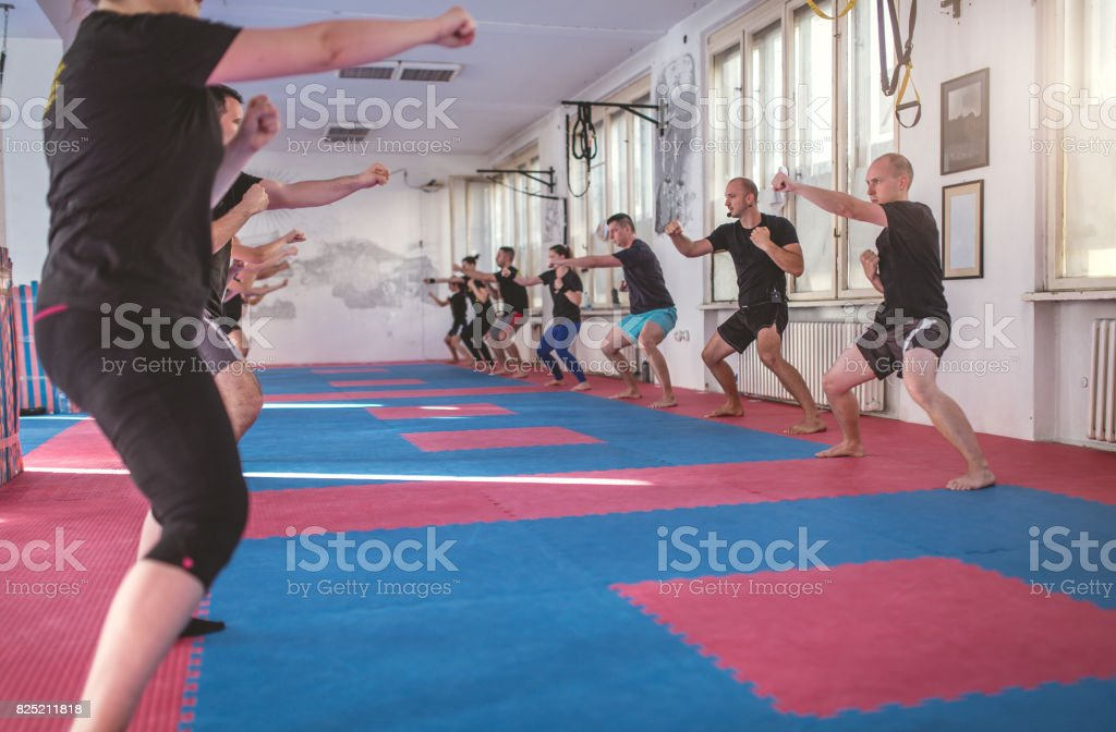 Combined tae bo with squats stock photo
