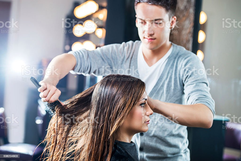 Combing a hair. stock photo