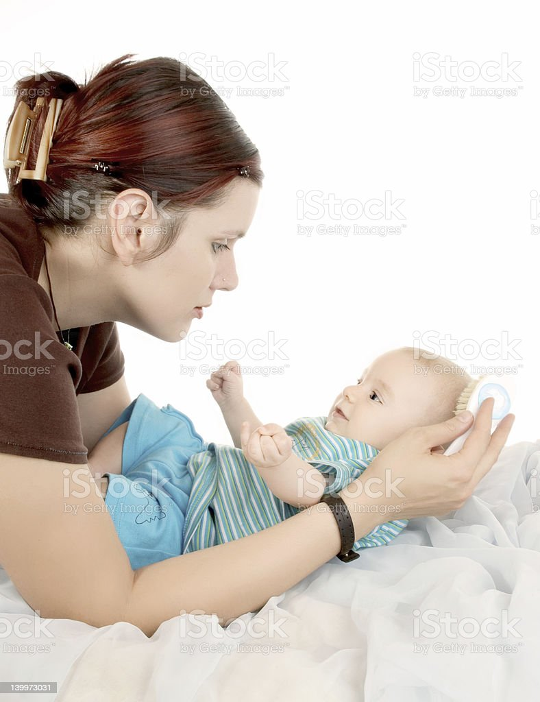 combing baby`s hair royalty-free stock photo