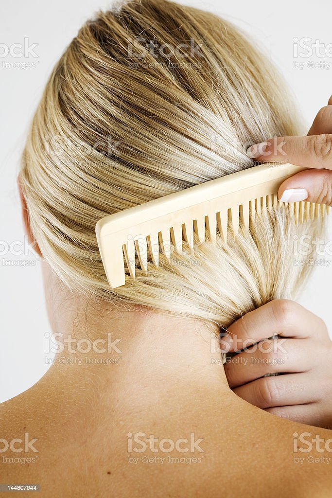 combing hair royalty-free stock photo