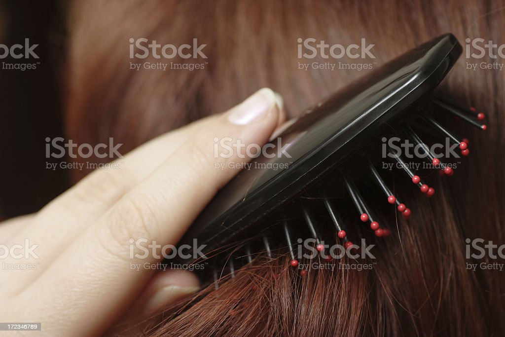 Combing of hair stock photo