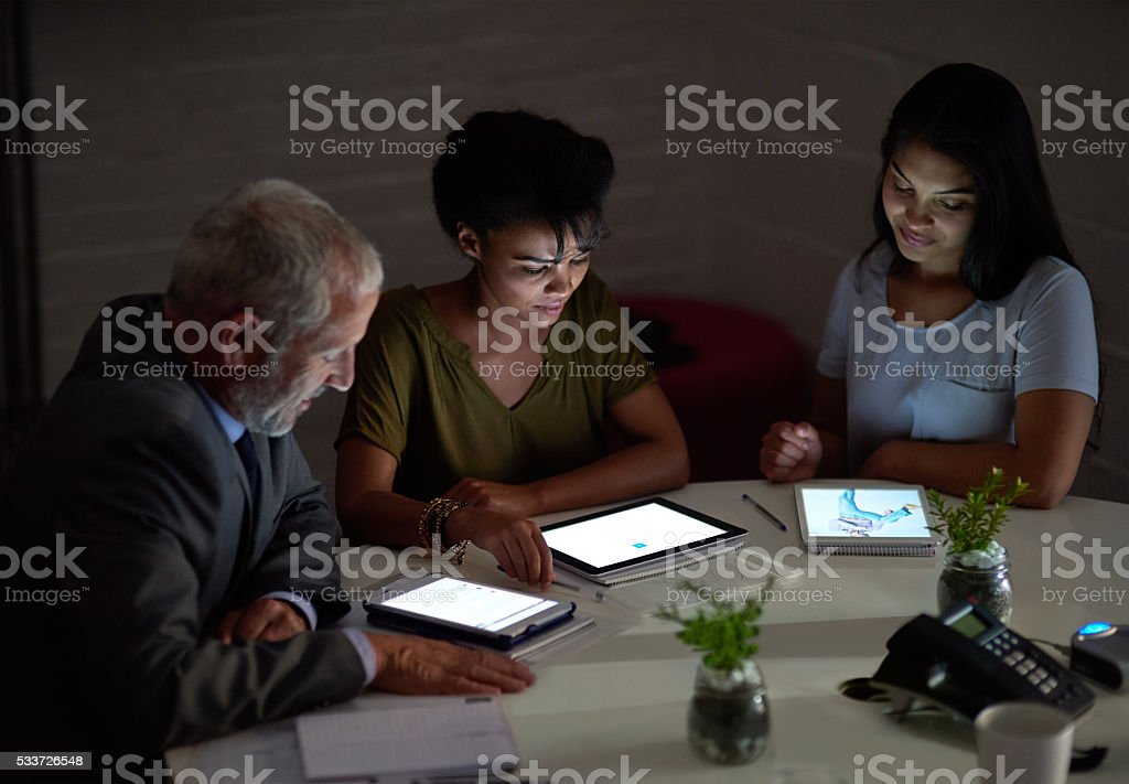 Combing over the data late into the eveing stock photo