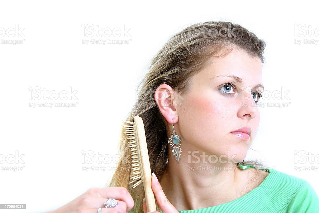 Combing royalty-free stock photo