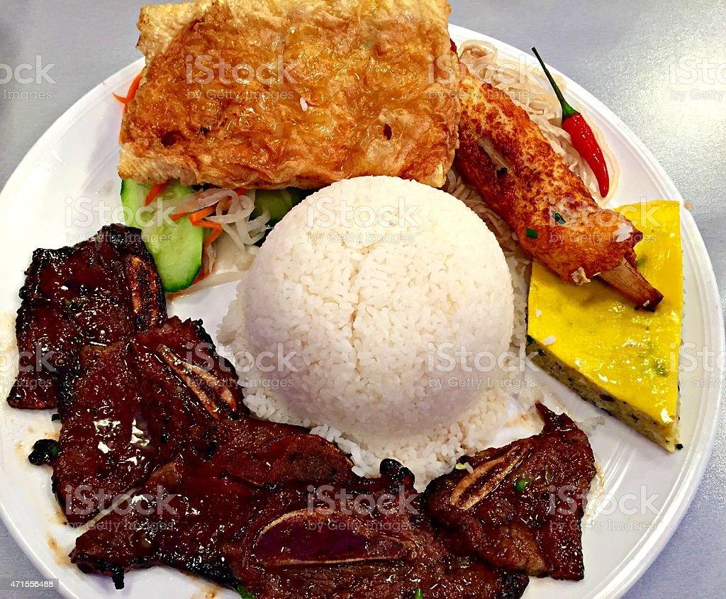 Combo of Vietnamese broken rice with BBQ beef stock photo