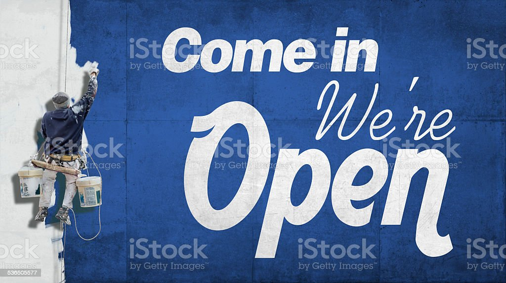 Come in, we are open stock photo