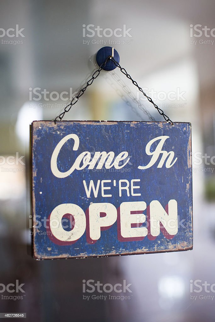 Come in we're open shop sign. stock photo