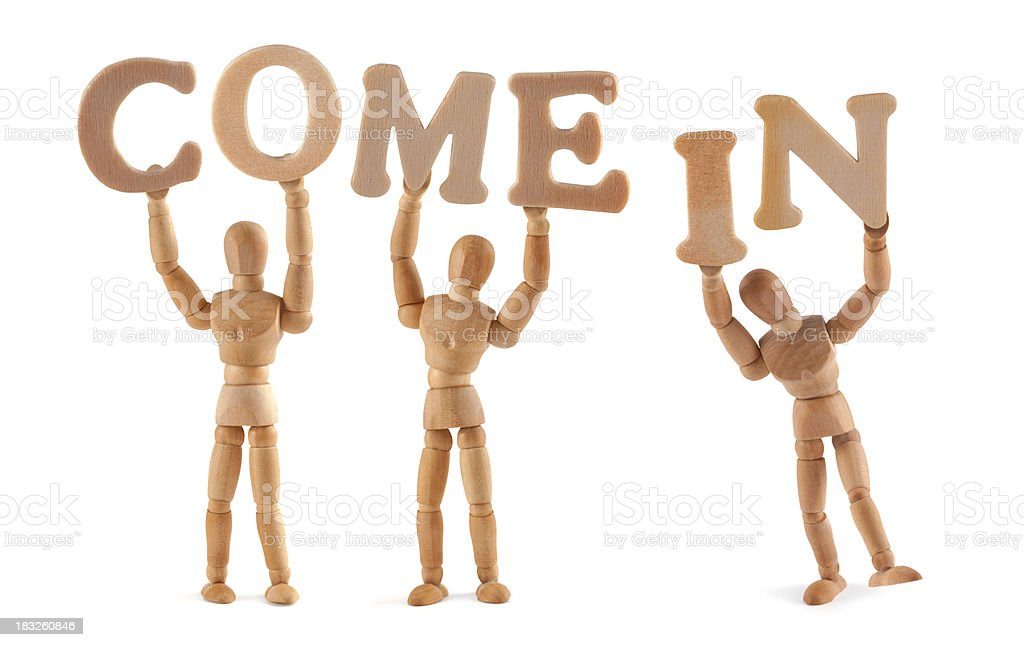 Come in - wooden mannequin holding this word royalty-free stock photo