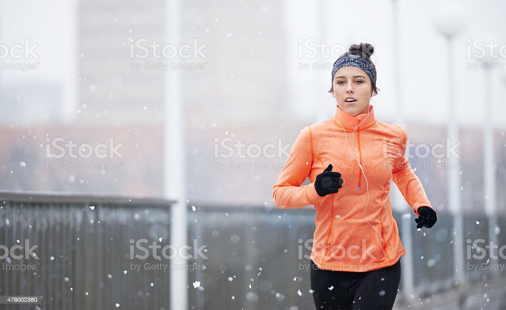 Come rain or shine...she'll keep running stock photo
