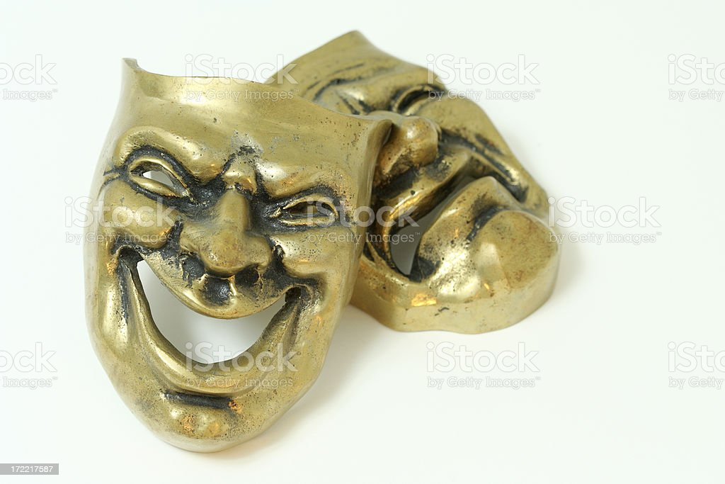 Comedy and tragedy brass masks on white background stock photo