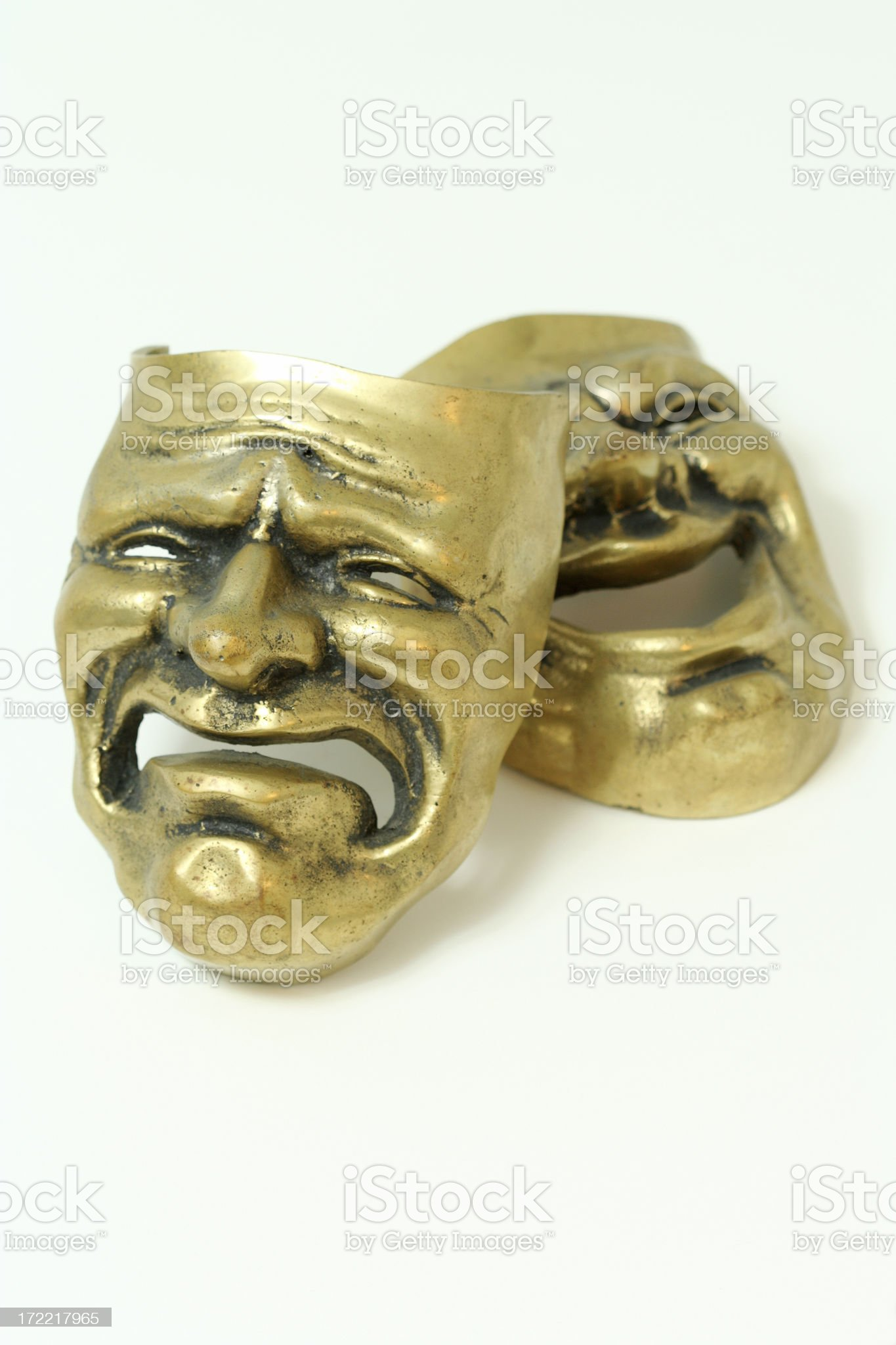 Comedy and tragedy brass masks on white background royalty-free stock photo
