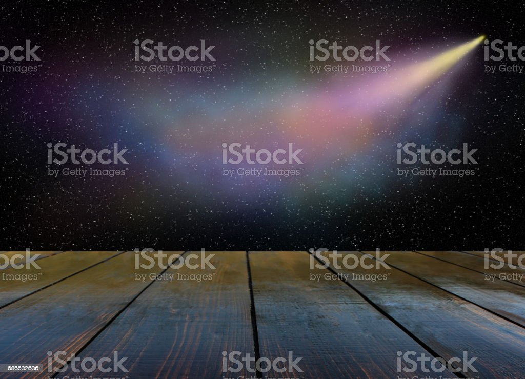 Comet flies in the darkness of outer space stock photo