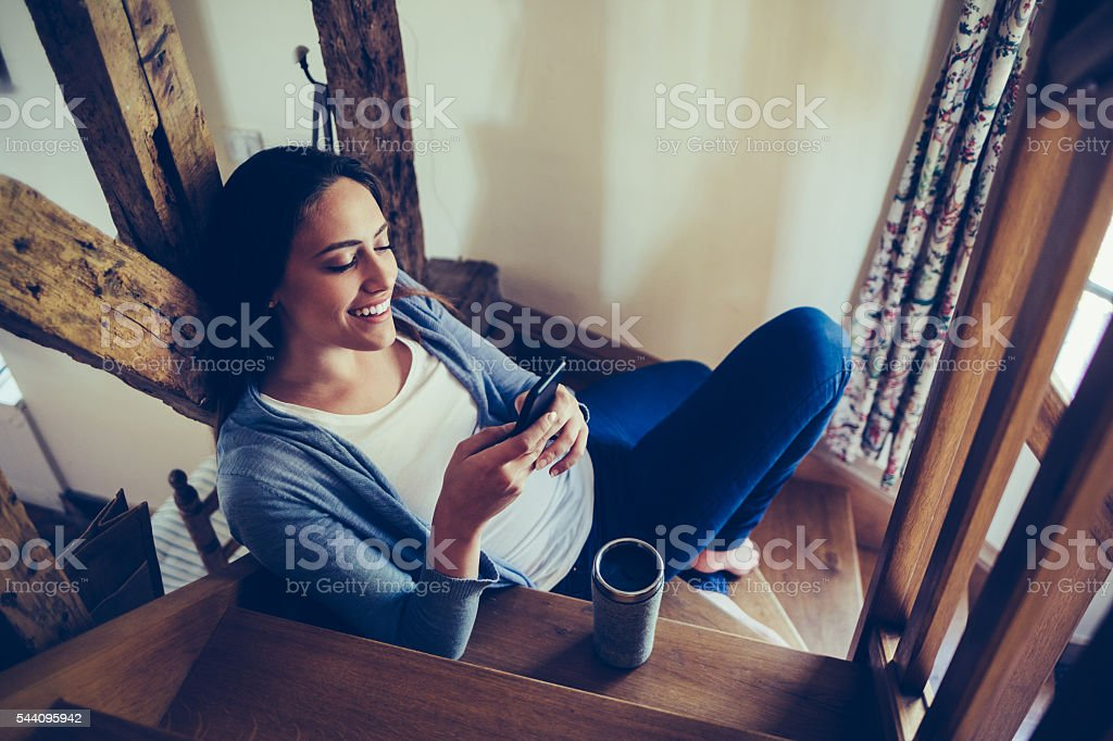 Comfortable at home and texting stock photo
