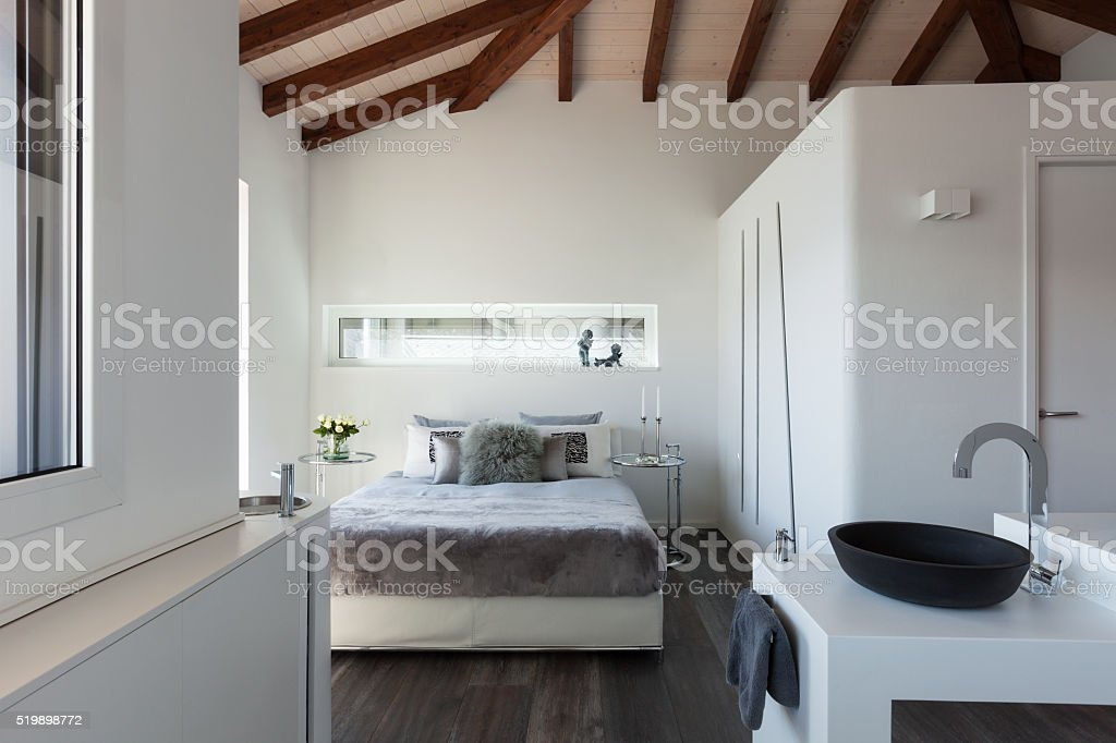 Comfortable bedroom of a loft stock photo