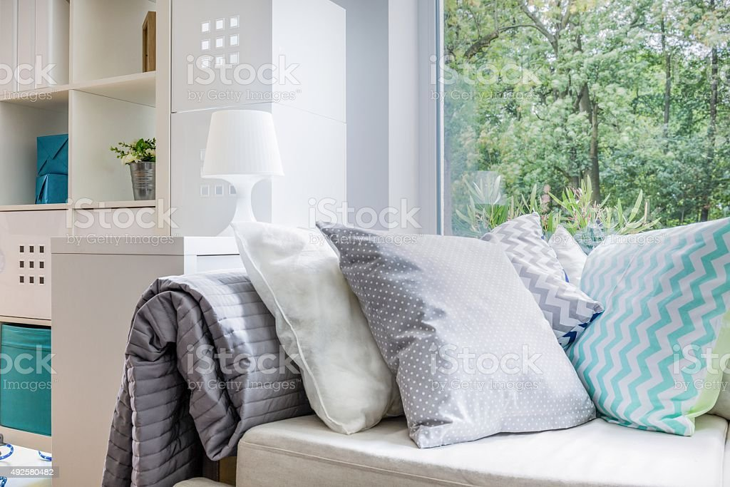 Comfortable couch and pillows stock photo