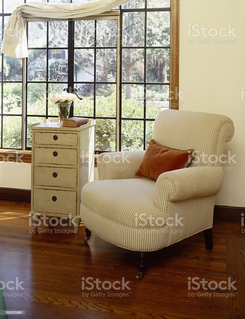 Comfortable cream armchair in front of window royalty-free stock photo