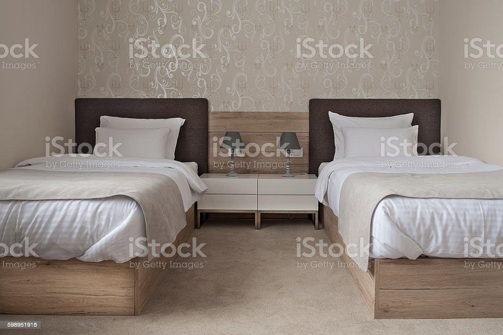 Comfortable hotel bedroom stock photo