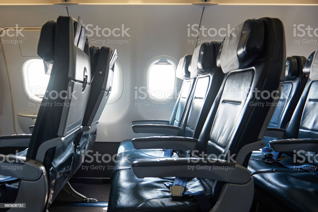 Comfortable leather seats in airplane stock photo
