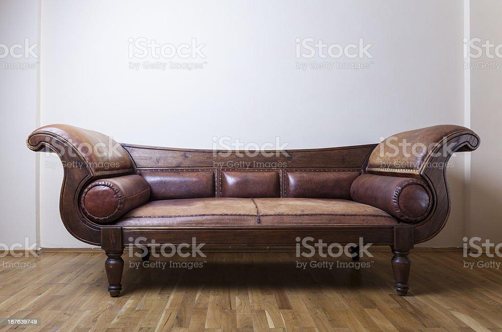 Comfortable leather sofa on white wall stock photo