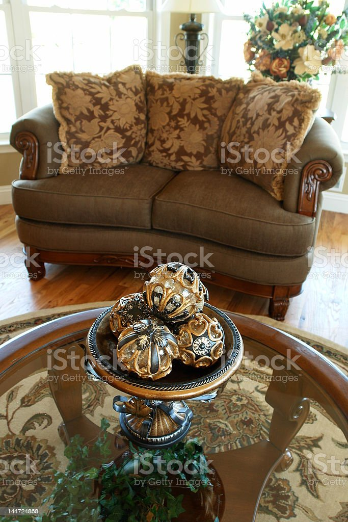 comfortable living room with decorative detail on coffee table royalty-free stock photo