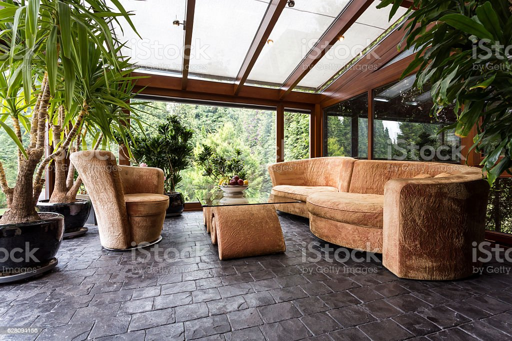 Comfortable lounge set in conservatory stock photo