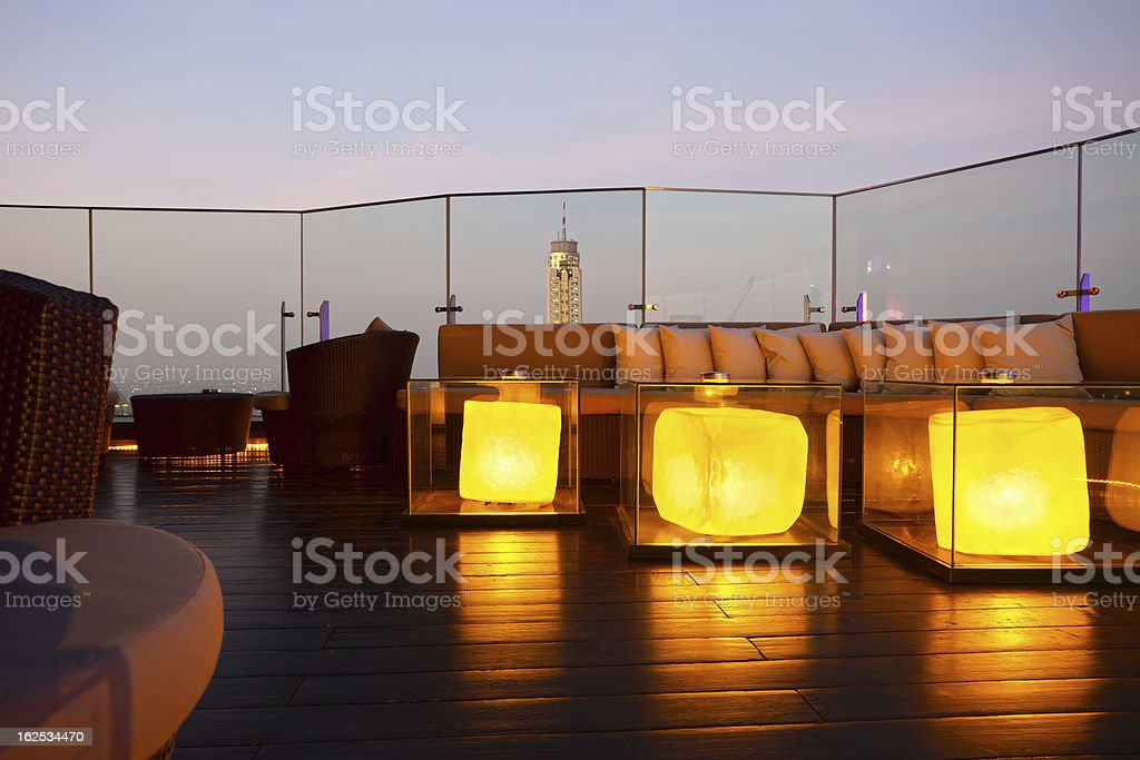Comfortable outdoor lounge with skyscraper in the background stock photo