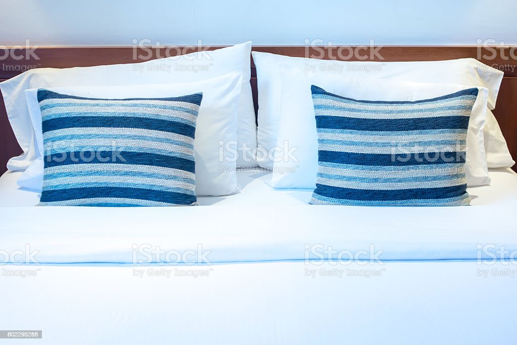 Comfortable pillows on bed in luxury room stock photo