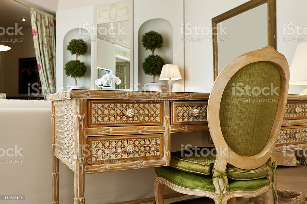 comfortable suite, wooden desk royalty-free stock photo