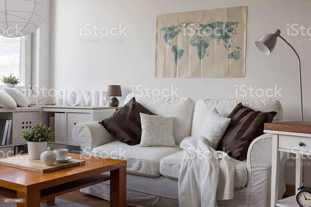 Comfortable white double sofa stock photo