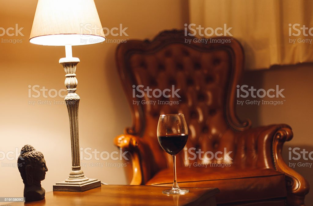 Comfortably at home with a glass of red wine stock photo
