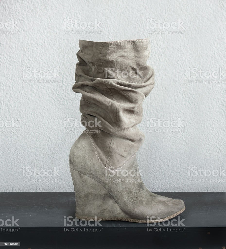 comfy boots sideview with high wedge heel stock photo
