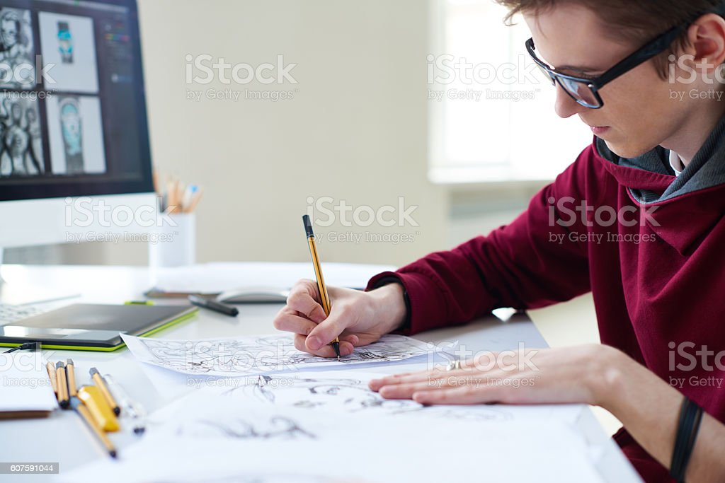 Comic artist at work stock photo