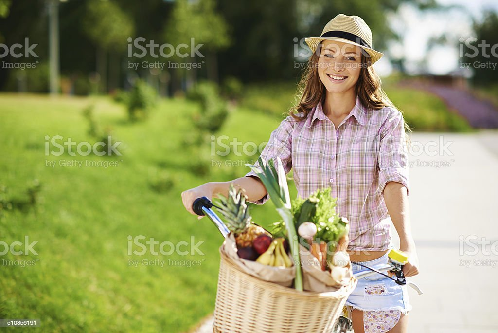 Coming from the grocer with her favourite greens stock photo