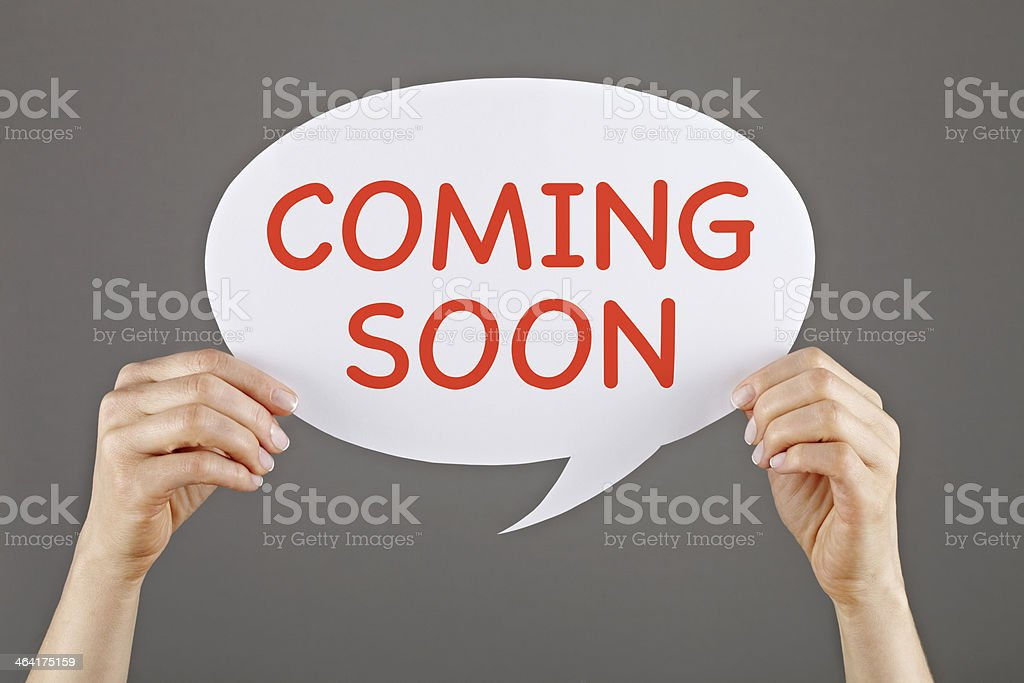 Coming Soon on white speech bubble royalty-free stock photo