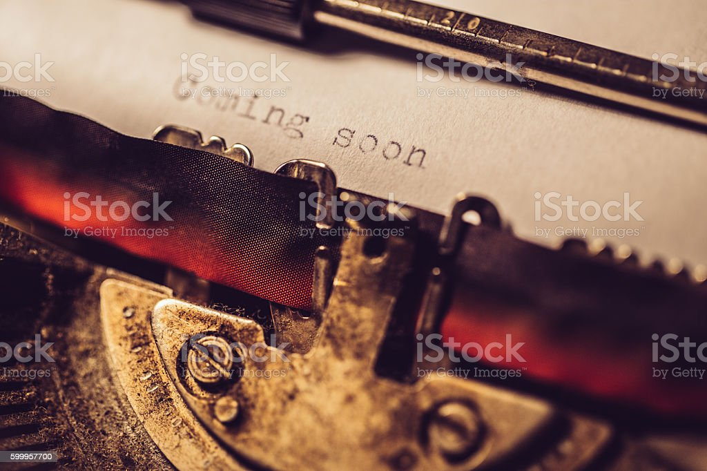 'Coming soon' typed using an old typewriter stock photo