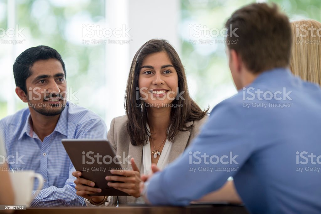 Coming Together in the Boardroom stock photo
