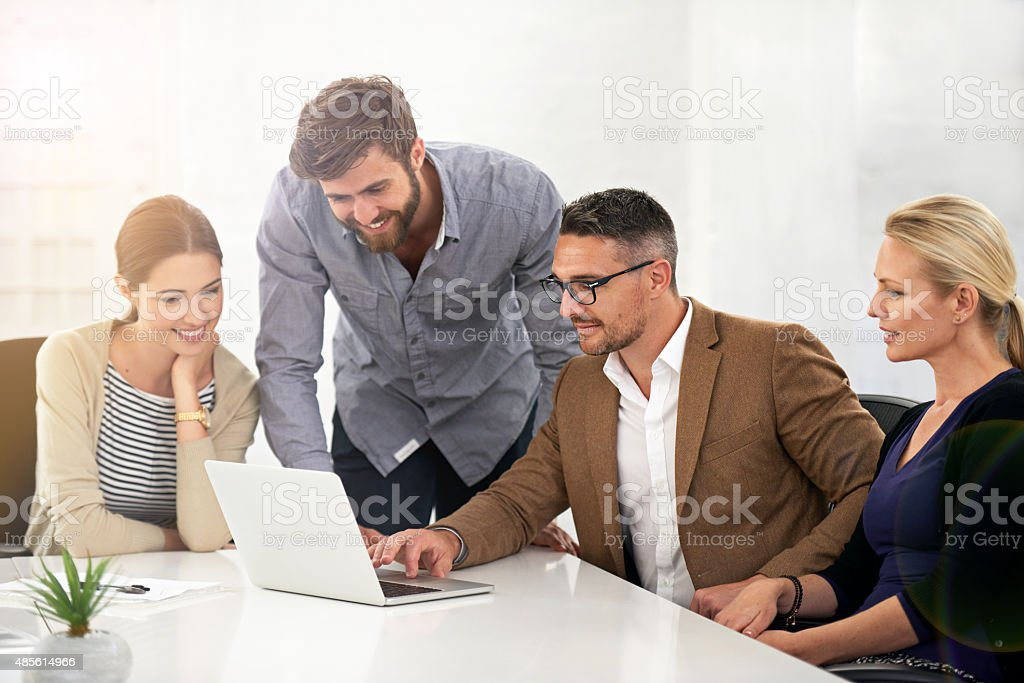 Coming up with great business solutions as a team stock photo