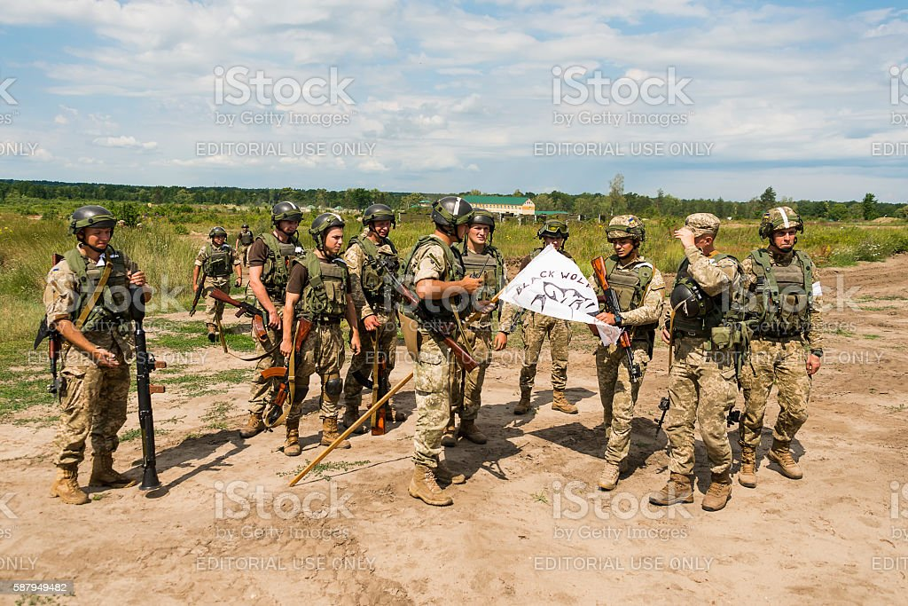 Commandos with white flag after atack at simulated enemy positio stock photo