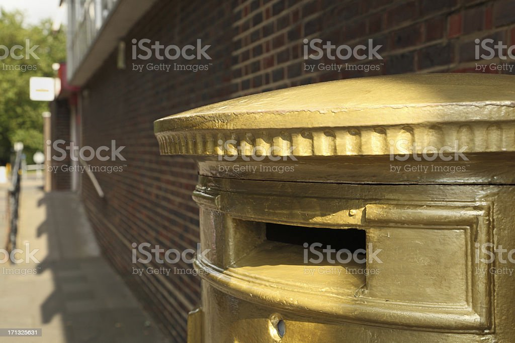 commemorative gold painted olympic post box in harlow essex england royalty-free stock photo