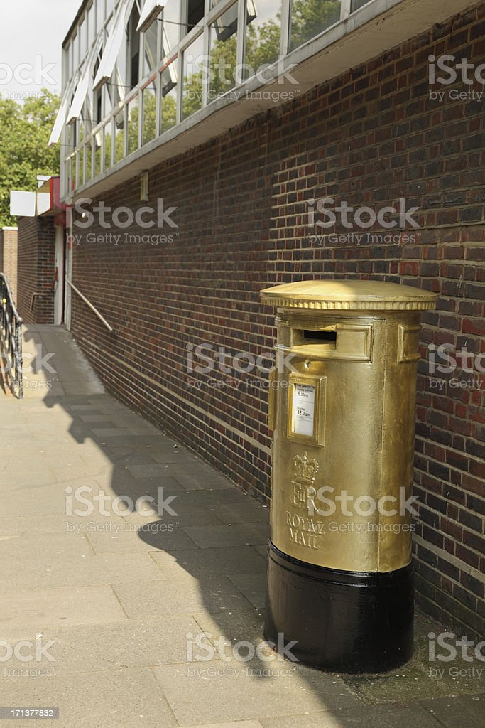 commemorative gold painted olympic post box in harlow essex engl stock photo